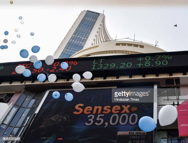 The digital broadcast on the facade of the Bombay Stock Exchange displays the benchmark share index SENSEX crossing 32000 points outside Bombay Stock...