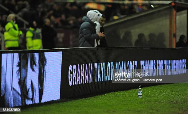 The digital display board with a tribute to the late Graham Taylor during the Emirates FA Cup Third Round Replay match between Lincoln City and...