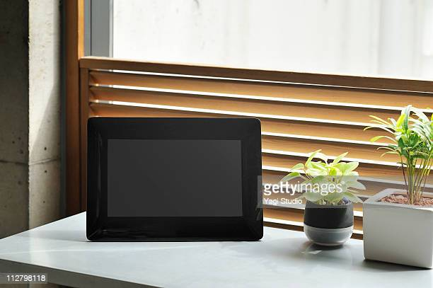The digital photo frame put on the window