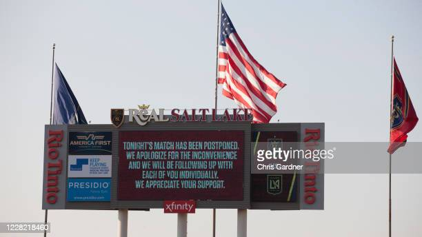 The digital scoreboard flashes an announcement that the game between Real Salt Lake and the Los Angeles FC was postponed at Rio Tinto Stadium on...
