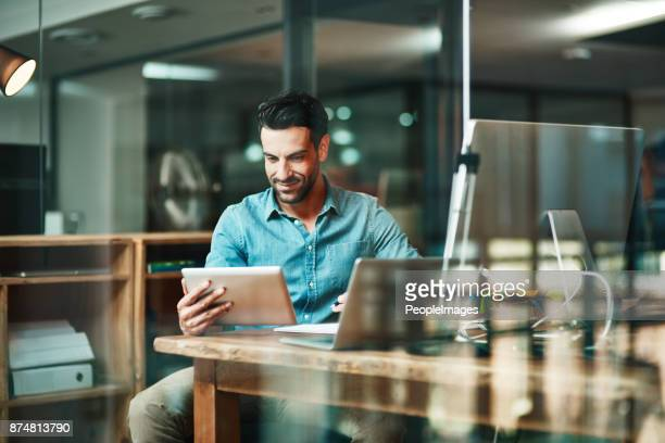 the digital worker gets things done - man in office stock photos and pictures