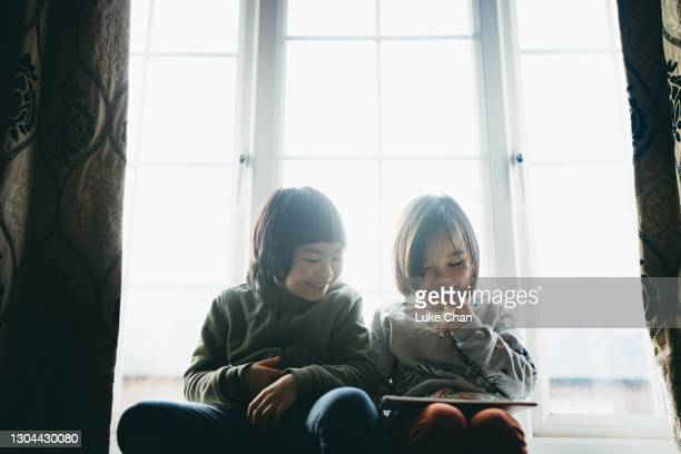 the digital world answers to their curiosity - digital native stock pictures, royalty-free photos & images