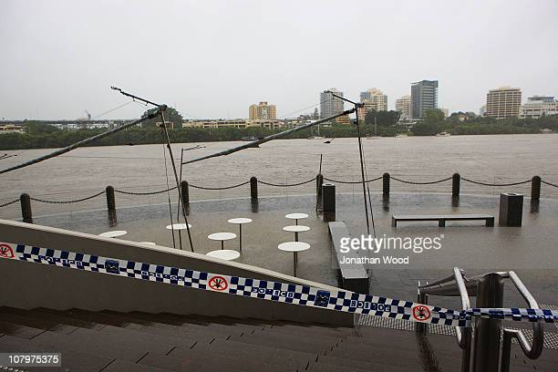The dining area of a restaurant on Eagle Street Pier is covered by flood water on January 11 2011 in Brisbane Australia 8 people so far have been...
