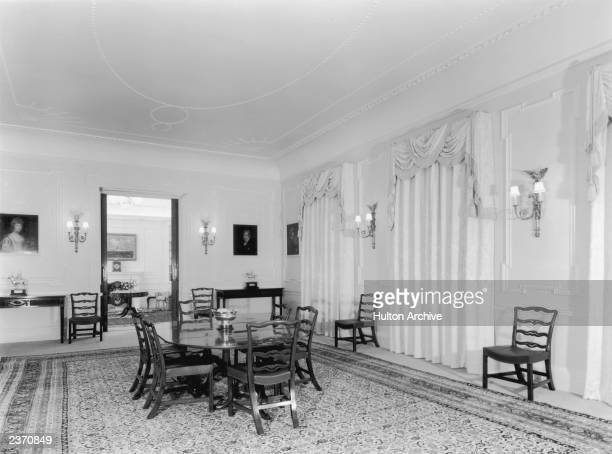 The dining room of Clarence House in London, 1949. The house was built in 1825-27 by John Nash for the Duke of Clarence, later King William IV. The...