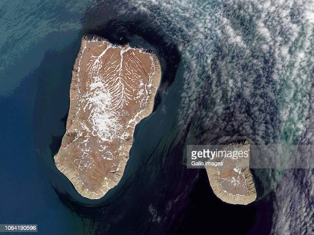 The Diomede Islands in the Bering Strait are separated by the International Date Line with Big Diomede Island 21 hours ahead of Little Diomede on...