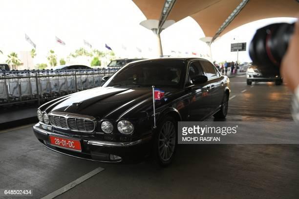 The diplomatic car transporting North Korean ambassador to Malaysia Kang Chol is seen driving up to the departure hall of the Kuala Lumpur...