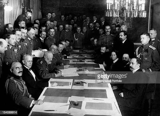 The diplomats and officers of Central Powers and Russia signing the Treaty of BrestLitovsk ratifying the exit of Russia from World War I BrestLitovsk...