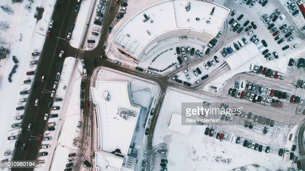 the directly above aerial drone view on the big office building with parking lot - belarus stock pictures, royalty-free photos & images