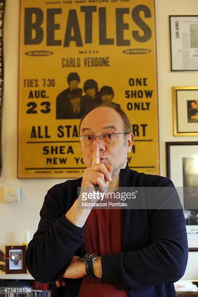 The director and actor Carlo Verdone photo shooted at home On the wall behind him a poster of The Beatles photo edited with his name that he got form...