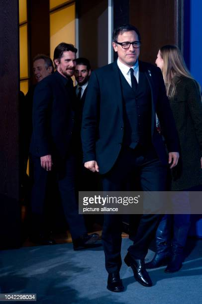 The director David O Russell and the actor Christian Bale attend the photocall for 'American Hustle' at the 64th annual Berlin Film Festival in...