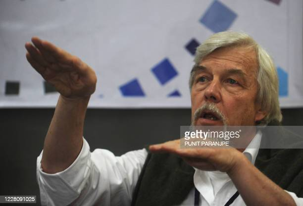 The director general of the European Organisation for Nuclear Research , Rolf-Dieter Heuer, speaks during a news conference at the Tata Institute of...