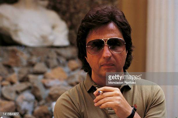 The director Michael Cimino with sunglasses and a sigarette in his hand Italy the '70s