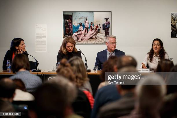 The director of CCCB Judit Carrera the director of Fundacion Photographic Social Vision Silvia Omedes the World Press Photo 2019 winner John Moore...