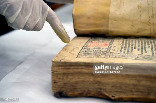 The director of Ecuadorean Conservartecuador foundation Ramiro Endara, shows some books of the Fray Ignacio de Quezada library, at the Convent of...