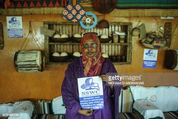 The Director of Somali NGO Save Somali Women and Children Amina Haji Elmi holds a message Save Somali Women and children as women gather to mark...