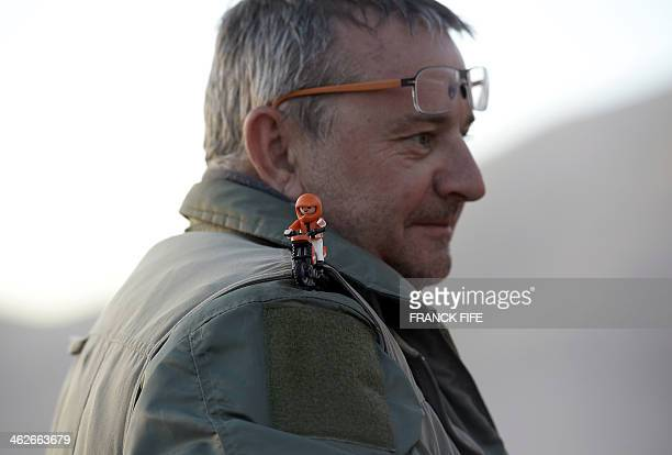 The director of the 2014 Rally Dakar Etienne Lavigne attends the start of the Stage 9 between Calama and Iquique Chile on January 14 2014 AFP PHOTO /...