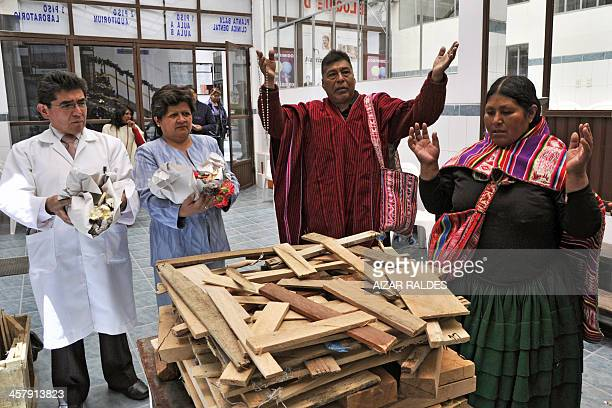 The director of the Agromont Hospital Jaime Agramont and 'Amautas' make a ritual to call the 'Ajayu' of a patient on December 5 2013 in El Alto 12 km...