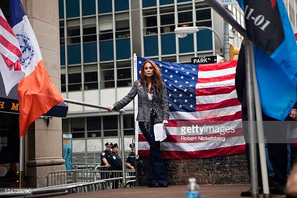 """The director of the American Freedom Defense Initiative, Pam Geller, stands on a stage during a """"9-11 Freedom Rally"""" September 11, 2011 as the public..."""