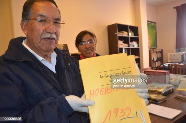 The director of the Bolivian mining archive Edgar Ramírez shows a file with documents of the mine owner Moritz Hochschild detailing his aid to Jews...