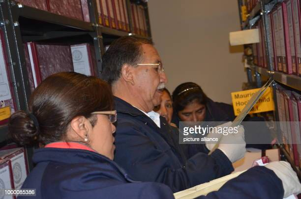 The director of the Bolivian mining archive Edgar Ramírez studies a file with documents of the mine owner Moritz Hochschild at the Bolivian Mining...