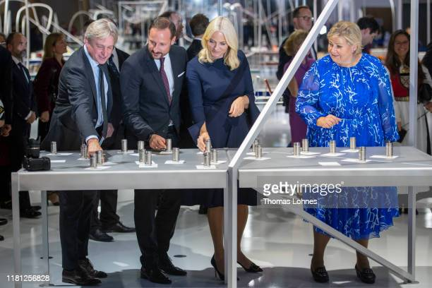 The director of the Buchmesse, Juergen Boos, Crown Prince Haakon of Norway, Crown Princess Mette-Marit of Norway and Norways Prime Minister Erna...