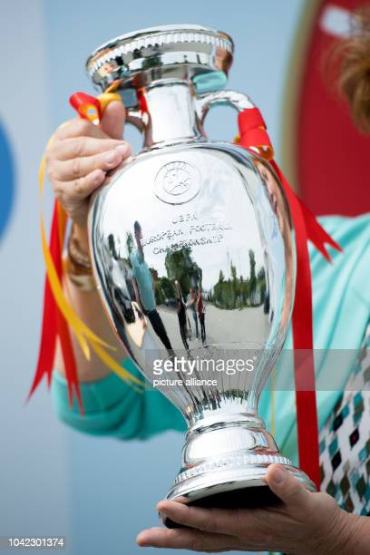 The director of the of the Cologne Central Customs Office, Monika Lucht-Kirchner, holds up a counterfeit European Championship cup in Cologne,...
