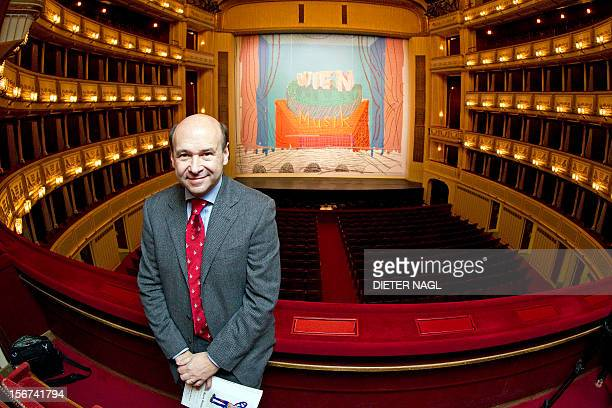 The director of the Vienna State Opera Dominique Meyer poses in front of the new iron curtain painting by British painter David Hockney on November...