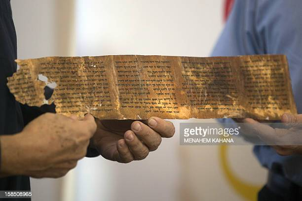 The DirectorGeneral of the Israel Antiquities Authority Shuka Dorfmann and Professor Yossi Matias managing director of Google Israel hold a replica...