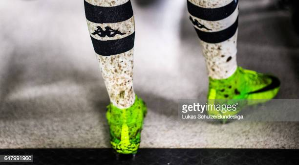 The dirty socks of player of Gladbach are seen during the Bundesliga match between Borussia Moenchengladbach and FC Schalke 04 at BorussiaPark on...