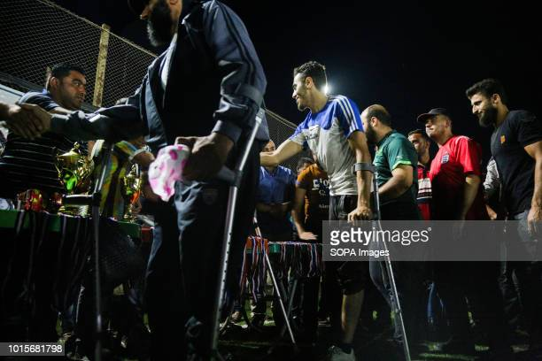 The disabled seen shaking hands A group of Syrian youths who have been injured and disabled as a result of the war came together and created a...