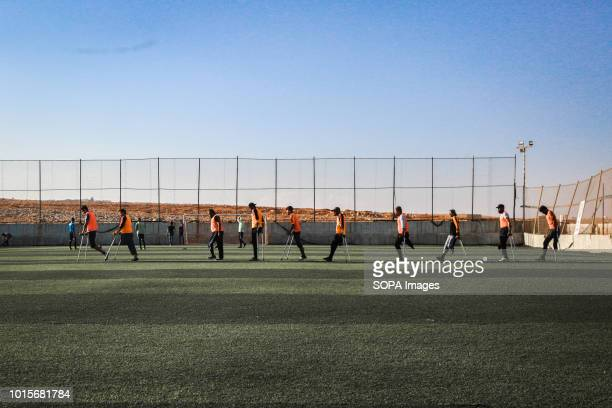 The disabled youths are seen jogging around the field A group of Syrian youths who have been injured and disabled as a result of the war came...