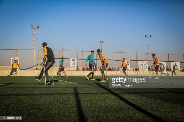 The disabled youths are seen playing soccer A group of Syrian youths who have been injured and disabled as a result of the war came together and...