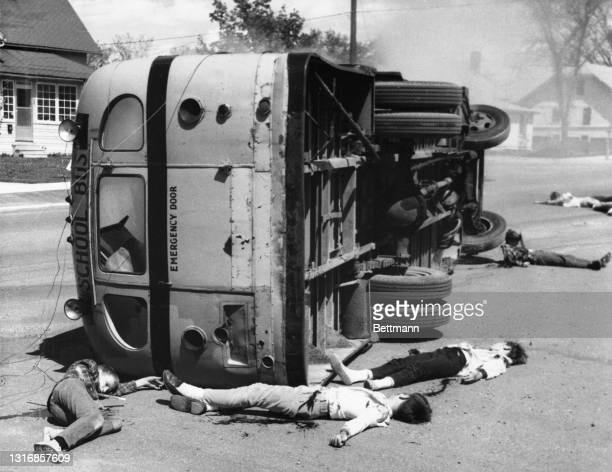 """The """"disaster"""" involved a loaded school bus, two automobiles, and a group of 44 teenagers as the """"victims."""" the youngsters wore realistic make up to..."""