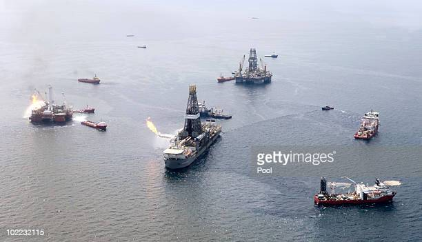 The Discoverer Enterprise burns off gas as it collects oil at the site of the Deepwater Horizon oil spill on June 19 2010 in the Gulf of Mexico off...