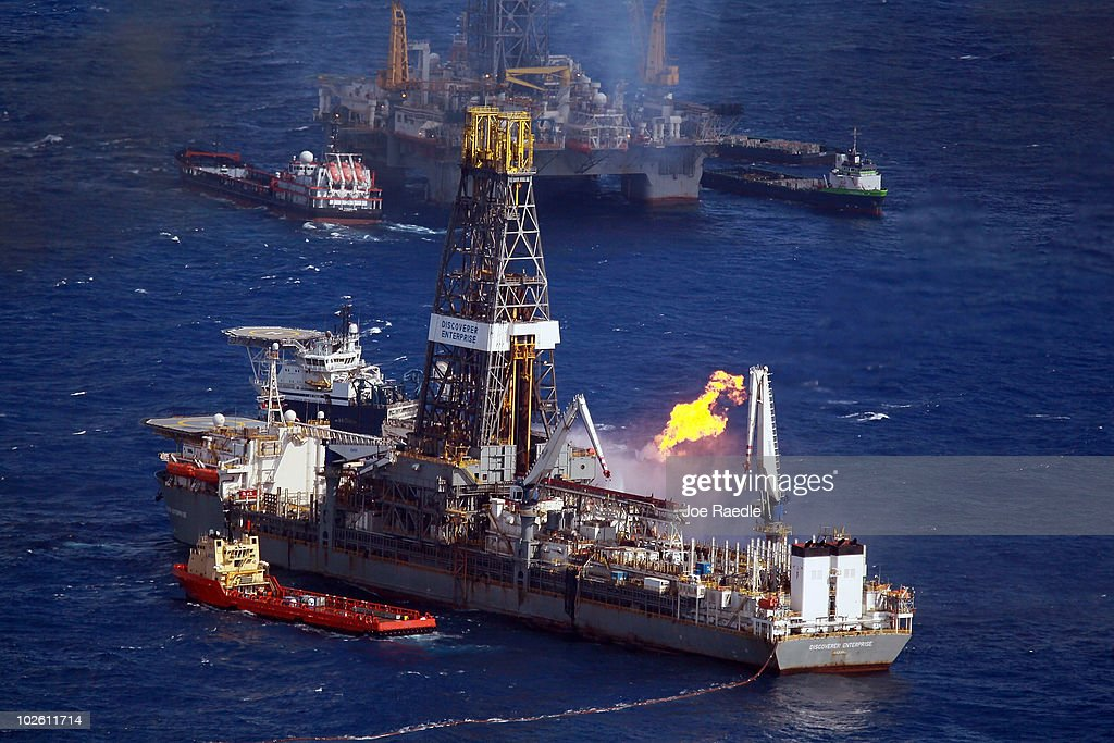 The Discoverer Enterprise drilling rig is seen as it continues the effort to recover oil from the Deepwater Horizon spill site on July 3, 2010 in the Gulf of Mexico off the Louisina coast. Millions of gallons of oil have spilled into the Gulf since the April 20 explosion on the drilling platform.