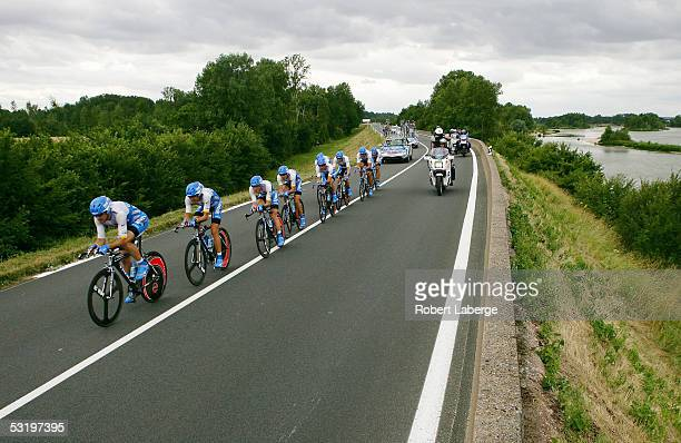 The Discovery Channel cycling team with Lance Armstrong of the US rides during the Team Time Trial Stage 4 of the 92nd Tour de France between Tours...