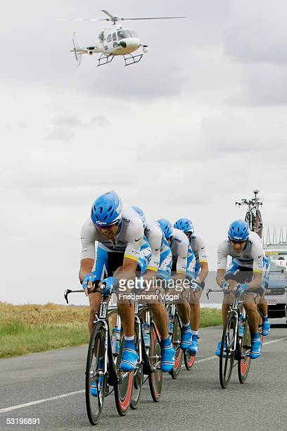 The Discovery Channel team rides as a helicopter flies overhead during Stage 4, the team time trial, of the 92nd Tour de France between Tours and...