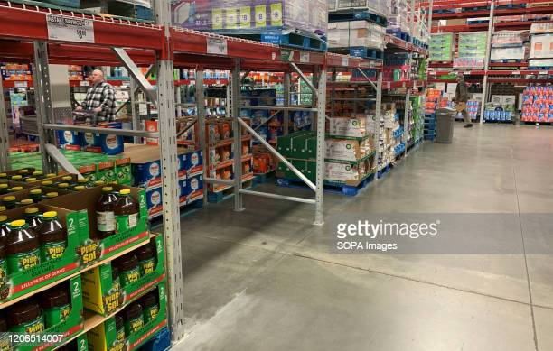 The disinfecting wipes area of Sam's Club has been stripped bare by panic buyers. Shoppers have been panic buying toilet paper, hand sanitizer, paper...