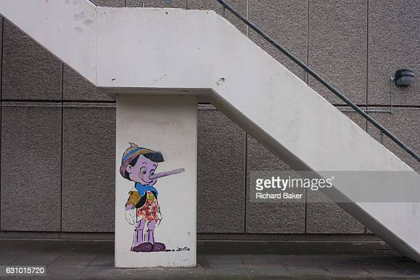 The Disney cartoon character Pinoccio seen beneath concrete stairs on the Aylesbury Estate on 4th January London borough of Southwark England