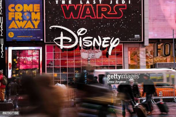 The Disney logo is displayed outside the Disney Store in Times Square, December 14, 2017 in New York City. The Walt Disney Company announced on...