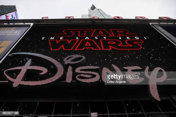 The Disney logo is displayed outside the Disney Store in Times Square December 14 2017 in New York City The Walt Disney Company announced on Thursday...