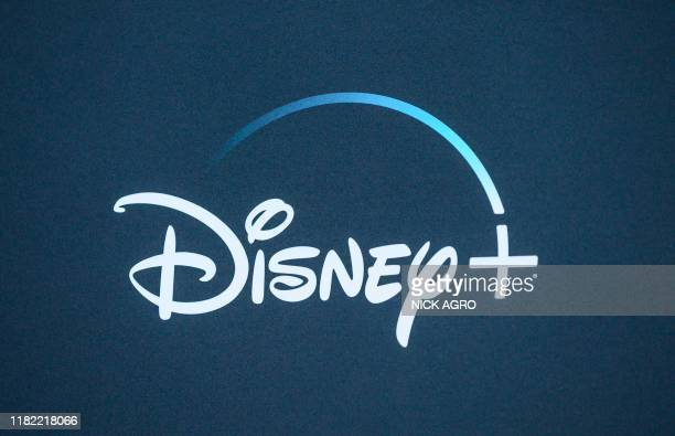 "The Disney+ logo is seen on the backdrop for the World Premiere of ""The Mandalorian"" at El Capitan theatre in Hollywood on November 13, 2019."