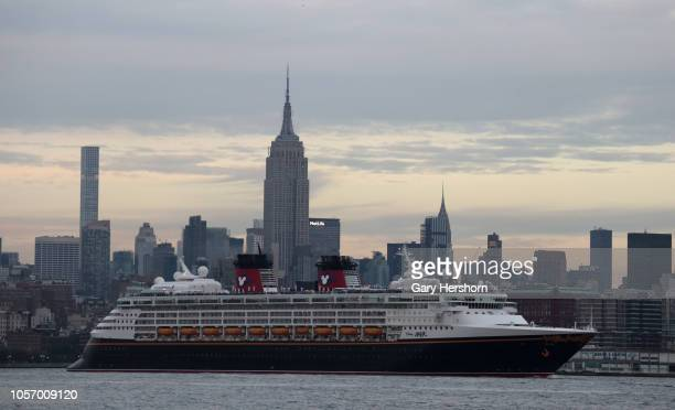 The Disney Magic cruise ship sails in the Hudson River in front of the Empire State Building in New York City on October 19, 2018 as seen from Jersey...