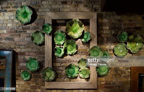 """The display folks at Jayson Home & Garden made """"art"""" for the wall behind the cash register by hanging a group of vintage Turkish trays n a giant..."""