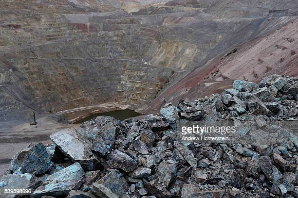 The distinctive blue of copper colors the rocks strwn about the giant Ray mine in in the Arizona desert The small mining communities of Kearny and...