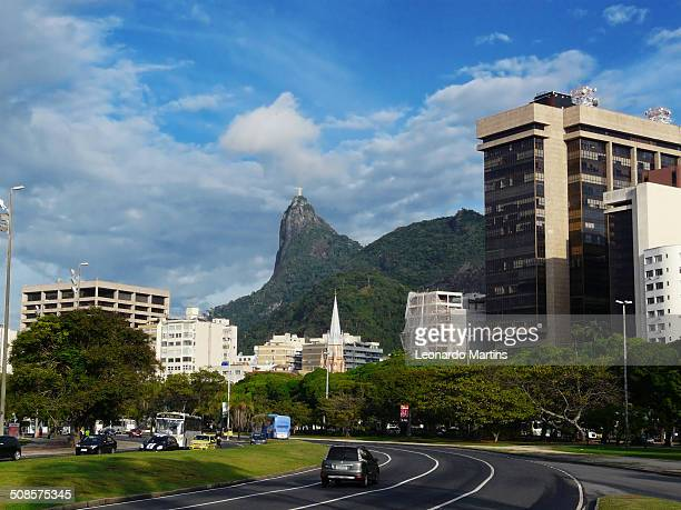 The district of Botafogo with the statue of Christ The Redeemer on the Corcovado Hill and the highspeed trakcs of Flamengo Park