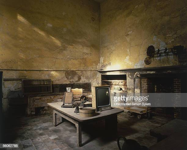 The disused kitchen of Calke Abbey, a Baroque mansion built on the site of a former Augustinian monastery in Derbyshire, circa 1995.