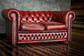 The divan is an honor of burgundy color in the interior