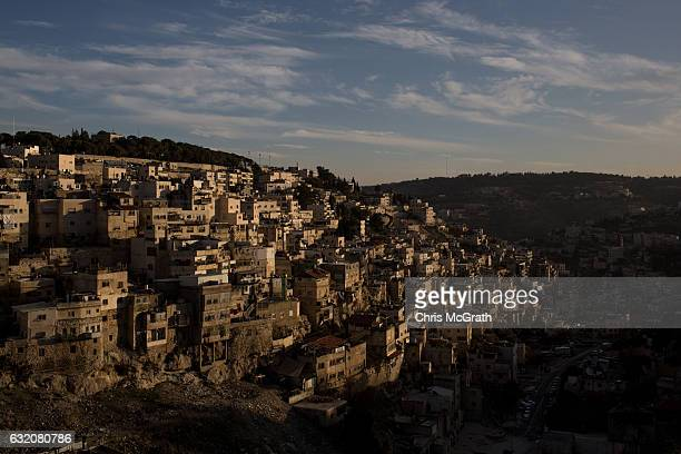 The divided neighbourhood of Abu Dis is seen from the Old City on January 12 2017 in Jerusalem Israel 70 countries attended the recent Paris Peace...