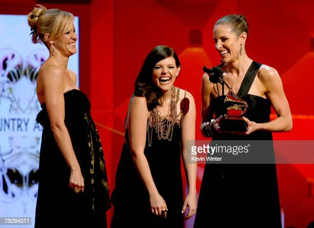"""The Dixie Chicks Martie Maguire, Natalie Maines and Emily Robinson accept their award for """"Best Country Album"""" for Taking the Long Way Home onstage..."""